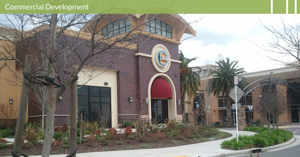 Melton Design Group, a landscape architecture firm, designed Dave and Busters in Roseville, CA. Dark classic brick building with cream colored concrete trim and almond mulch landscaping complete with desert plants.