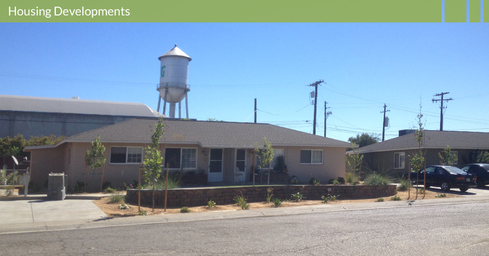 Melton Design Group, a landscape architecture firm, designed this outdoor space for the Housing Authority of Butte County in Gridley, CA. This low water use landscape restoration is complete with grassy plants and a small brick wall for embellishment.