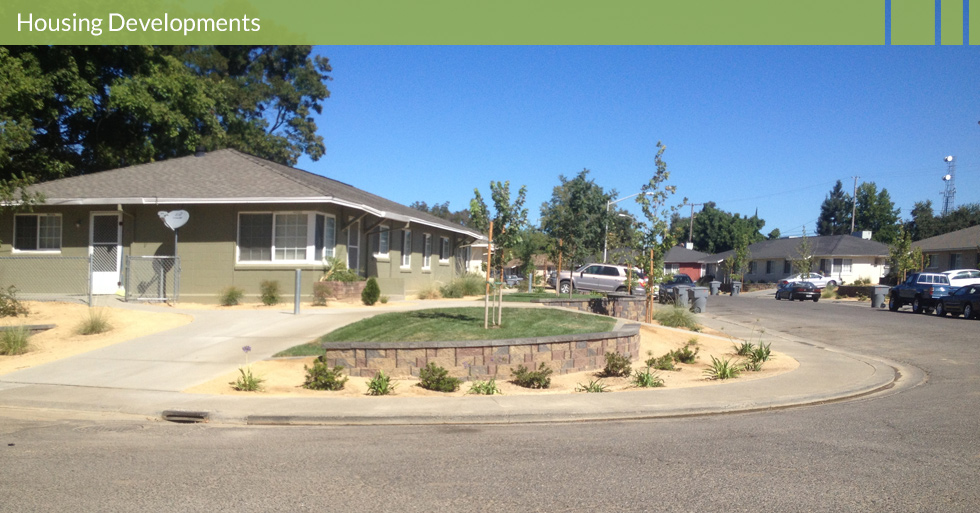 Melton Design Group, a landscape architecture firm, designed this outdoor space for the Housing Authority of Butte County in Gridley, CA. This low maintenance and water use landscape is easy to keep looking fresh, complete with beautiful neutral colored stone work.