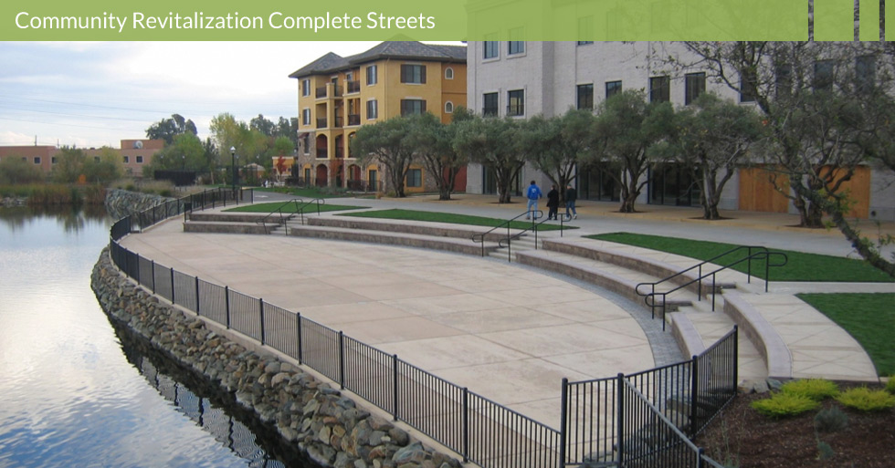Melton Design Group designed the revitalization of the Italian-inspired Towncenter Blvd. in El Dorado Hills, CA. Store-front enhancement, amphitheater, man-made lake, water features, walking trails, and olive tree lined streets.