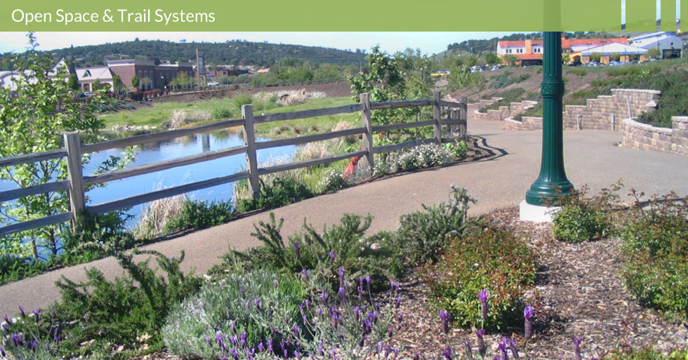 Melton Design Group, landscape architecture firm designed the trail system at Town Center, El Dorado Hills, CA.  Featuring a man-made lake with a water feature and native plants to enhance and guide pedestrians.